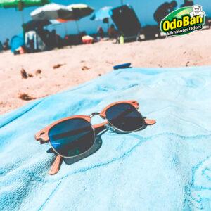 Sunglasses on towel at beach
